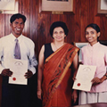 Mrs. Nonis giving Scholarships for University to Plantation workers' Children